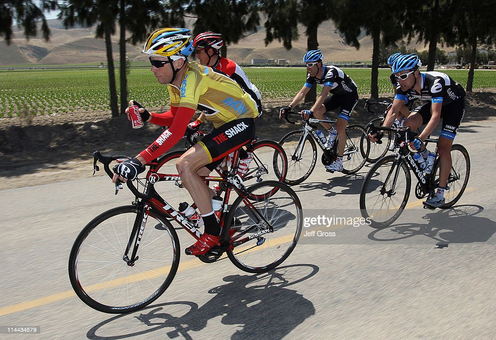 Radioshack team rider Chris Horner (L) of the USA drinks a coke as he leads a pack of riders out of a feed zone during stage five of the 2011 AMGEN Tour of California from Seaside to Paso Robles on May 19, 2011 in Greenfield, California.