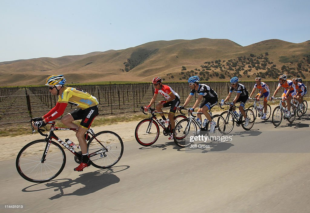 Radioshack team rider Chris Horner (L) of the USA eats as he leads a pack of riders out of a feed zone during stage five of the 2011 AMGEN Tour of California from Seaside to Paso Robles on May 19, 2011 in Greenfield, California.