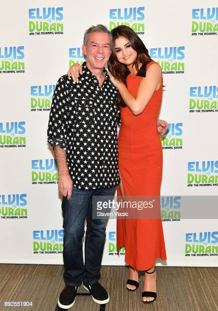 Radio/TV personality Elvis Duran and singer/actress Selena Gomez pose for a photo at the 'Elvis Duran Z100 Morning Show' at Z100 Studio on June 5...