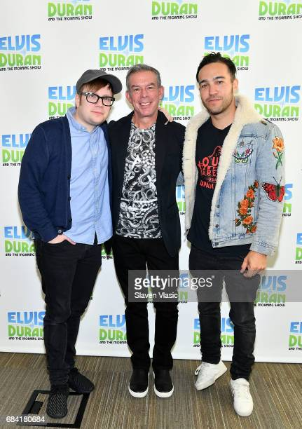 Radio/TV personality Elvis Duran Patrick Stump and Pete Wentz of of rock band 'Fall Out Boy' pose for a photo at 'The Elvis Duran Z100 Morning Show'...