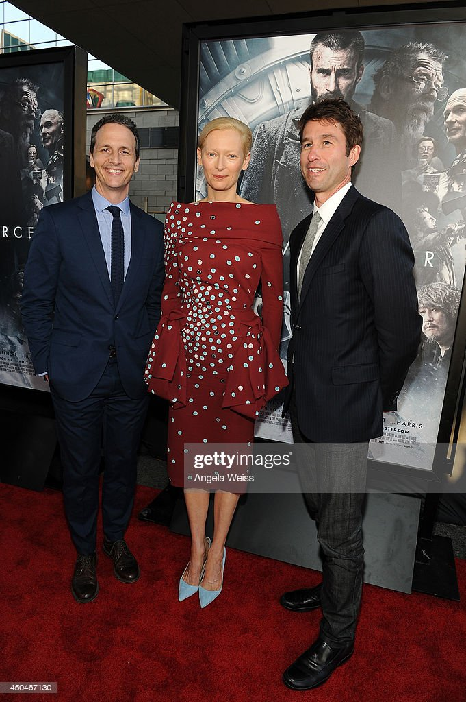 RADiUS-TWC co-president Jason Janego (L), actress <a gi-track='captionPersonalityLinkClicked' href=/galleries/search?phrase=Tilda+Swinton&family=editorial&specificpeople=202991 ng-click='$event.stopPropagation()'>Tilda Swinton</a> and RADiUS-TWC co-president Tom Quinn (R) attend the opening night premiere of 'Snowpiercer' during the 2014 Los Angeles Film Festival at Regal Cinemas L.A. Live on June 11, 2014 in Los Angeles, California.