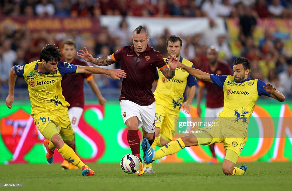 Radja Naiggolan of AS Roma competes for the ball with AC Chievo Verona players during the Serie A match between AS Roma and AC Chievo Verona at...
