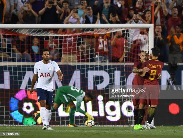 Radja Nainggolan and Diego Perotti of AS Roma celebrate a goal against Tottenham Hotspur during their International Champions Cup match between...