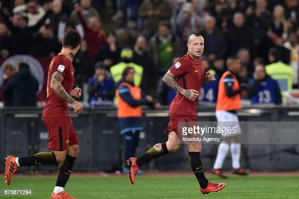 Radja Nainggolan and Diego Perotti of AS Roma celebrate after winning the Italian Serie A soccer match between AS Roma and SS Lazio at the Stadio...