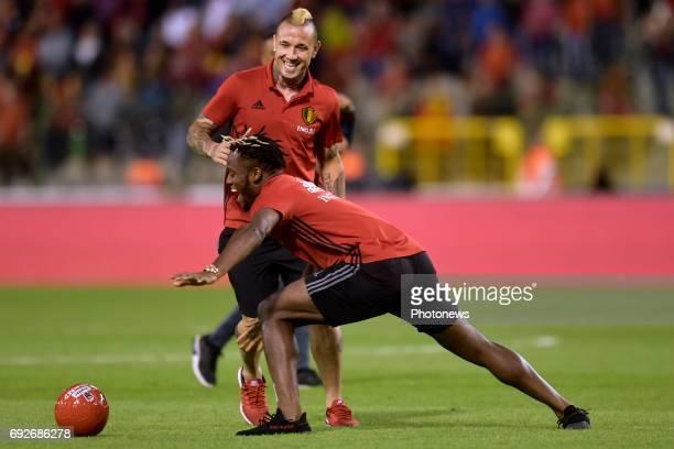 Radja Nainggolan midfielder of Belgium and Michy Batshuayi forward of Belgium play ball after a FIFA international friendly match between Belgium and...
