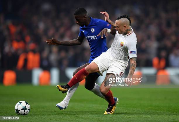 Radja Nainggolan of AS Roma and Antonio Rudiger of Chelsea battle for possession during the UEFA Champions League group C match between Chelsea FC...