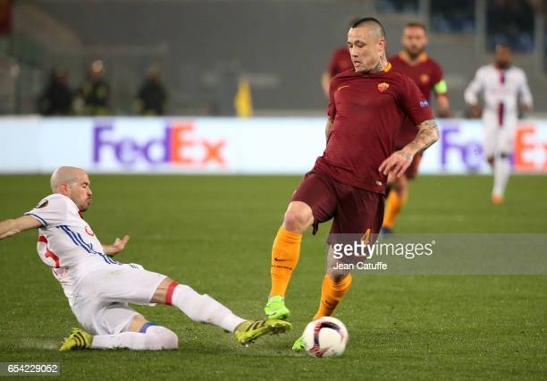 Radja Nainggolan of AS Roma and Christophe Jallet of Lyon in action during the UEFA Europa League Round of 16 second leg match between AS Roma and...