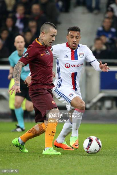 Radja Nainggolan of AS Roma and Corentin Tolisso of Lyon in action during the UEFA Europa League Round of 16 first leg match between Olympique...