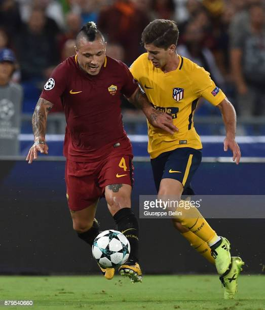 Radja Nainggolan of AS Roma and Luciano Vietto of Club Atletico de Madrid in action during the UEFA Champions League group C match between AS Roma...