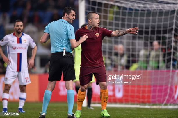 Radja Nainggolan of AS Roma argues with the referee during the UEFA Europa League soccer match between AS Roma and Olympique Lyonnais at Stadio...
