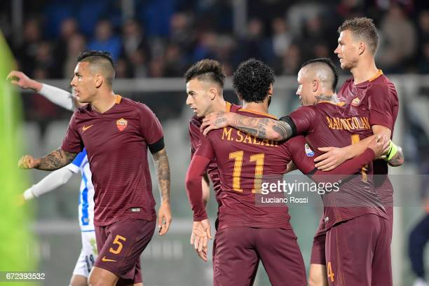 Radja Nainggolan of AS Roma celebrates with teammates after scoring a goal during the Serie A match between Pescara Calcio and AS Roma at Adriatico...