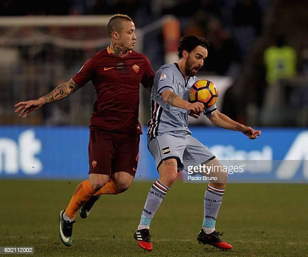 Radja Nainggolan of AS Roma competes for the ball with Luca Cigarini of UC Sampdoria during the TIM Cup match between AS Roma and UC Sampdoria at...