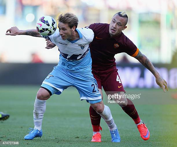 Radja Nainggolan of AS Roma competes for the ball with Lucas Biglia of SS Lazio during the Serie A match between SS Lazio and AS Roma at Stadio...