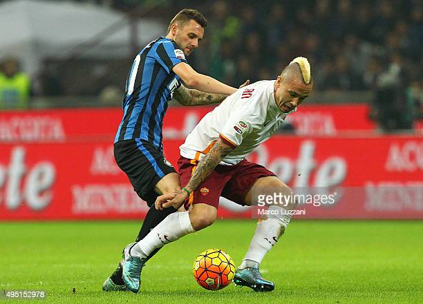 Radja Nainggolan of AS Roma competes for the ball with Marcelo Brozovic of FC Internazionale Milano during the Serie A match between FC...