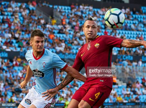 Radja Nainggolan of AS Roma competes for the ball with Nemanja Radoja of Celta de Vigo during the preseason friendly match between Celta de Vigo and...