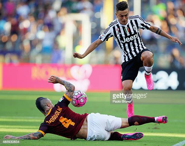 Radja Nainggolan of AS Roma competes for the ball with Paulo Dybala of Juventus FC during the Serie A match between AS Roma and Juventus FC at Stadio...