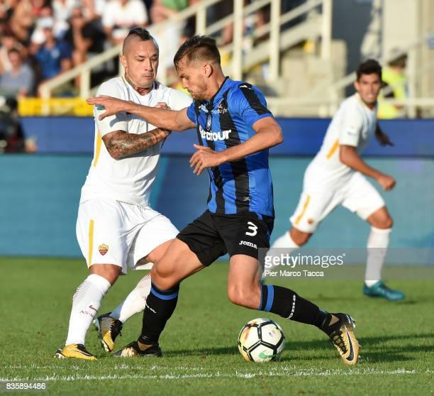 Radja Nainggolan of AS Roma competes for the ball with Rafael Toloi of Atalanta BC during the Serie A match between Atalanta BC and AS Roma at Stadio...