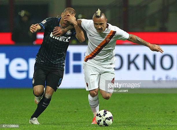 Radja Nainggolan of AS Roma competes for the ball with Rodrigo Palacio of FC Internazionale Milano during the Serie A match between FC Internazionale...