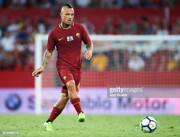 Radja Nainggolan of AS Roma in action during a Pre Season Friendly match between Sevilla FC and AS Roma at Estadio Ramon Sanchez Pizjuan on August 10...