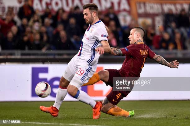 Radja Nainggolan of AS Roma is challenged by Lucas Tousart of Olympique Lyonnais during the UEFA Europa League match between Roma and Olympique...