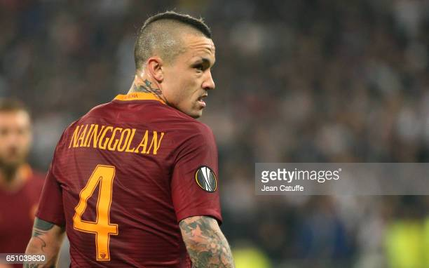 Radja Nainggolan of AS Roma looks on during the UEFA Europa League Round of 16 first leg match between Olympique Lyonnais and AS Roma at Parc OL on...