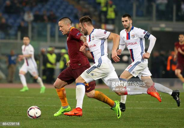 Radja Nainggolan of AS Roma Lucas Tousart and Maxime Gonalons of Lyon in action during the UEFA Europa League Round of 16 second leg match between AS...