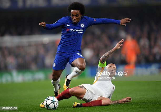 Radja Nainggolan of AS Roma tackles Willian of Chelsea during the UEFA Champions League group C match between Chelsea FC and AS Roma at Stamford...
