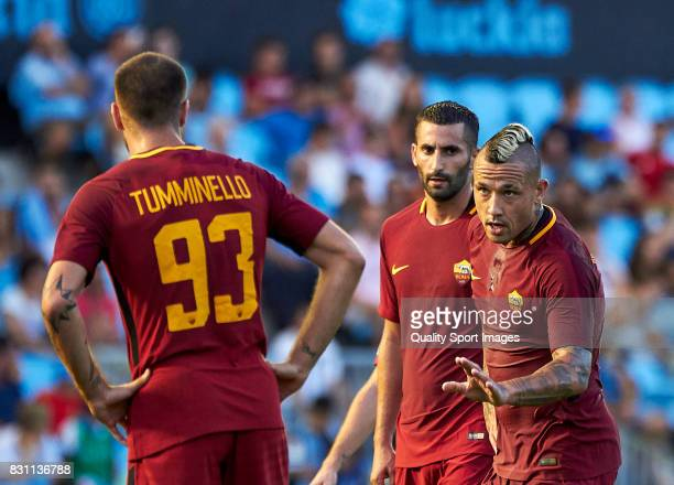 Radja Nainggolan of AS Roma talk with Marco Tumminello of AS Roma during the preseason friendly match between Celta de Vigo and AS Roma at Balaidos...