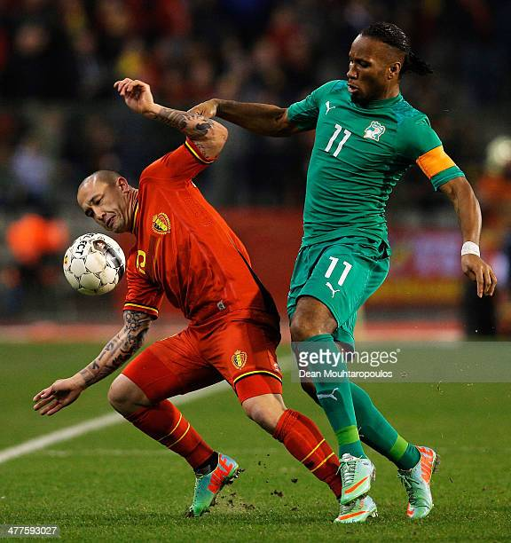 Radja Nainggolan of Belgium and Didier Drogba of Ivory Coast battle for the ball during the International Friendly match between Belgium and Ivory...