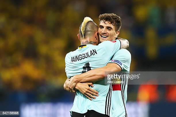 Radja Nainggolan of Belgium ceelbrates scoring his team's first goal with teammate Thomas Meunier of Belgium during the UEFA EURO 2016 Group E match...