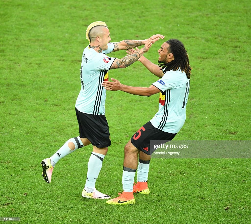 Radja Nainggolan (L) of Belgium celebrates after scoring a goal during the Euro 2016 quarter-final football match between Wales and Belgium at the Stadium Pierre Mauroy in Lille, France on July 1, 2016.