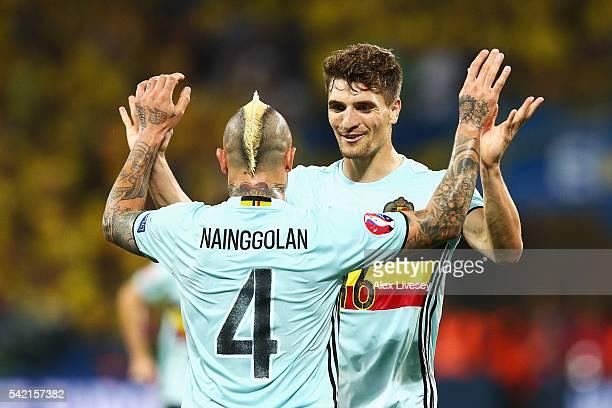 Radja Nainggolan of Belgium celebrates scoring his team's first goal with Thomas Meunier of Belgium during the UEFA EURO 2016 Group E match between...