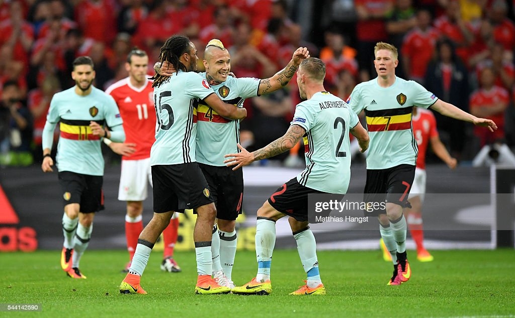 Radja Nainggolan (C) of Belgium celebrates scoring his team's first goal with his team mate Jason Denayer (L) and Toby Alderweireld (R) during the UEFA EURO 2016 quarter final match between Wales and Belgium at Stade Pierre-Mauroy on July 1, 2016 in Lille, France.