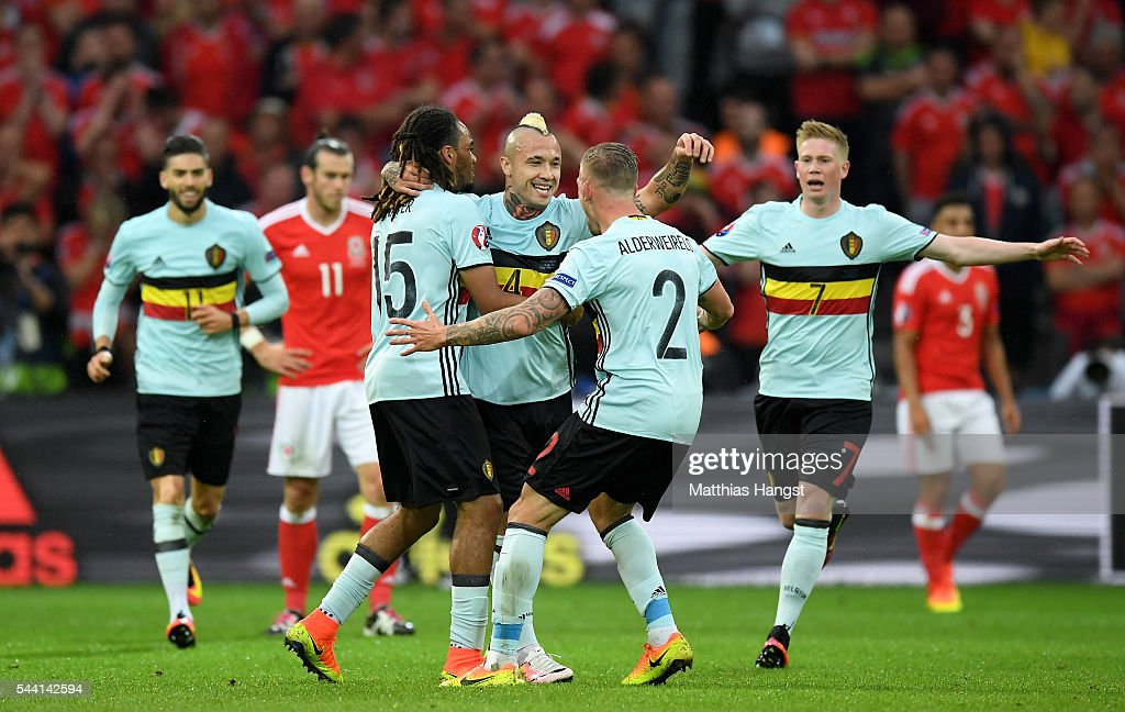 <a gi-track='captionPersonalityLinkClicked' href=/galleries/search?phrase=Radja+Nainggolan&family=editorial&specificpeople=6339191 ng-click='$event.stopPropagation()'>Radja Nainggolan</a> (C) of Belgium celebrates scoring his team's first goal with his team mate <a gi-track='captionPersonalityLinkClicked' href=/galleries/search?phrase=Jason+Denayer&family=editorial&specificpeople=10953601 ng-click='$event.stopPropagation()'>Jason Denayer</a> (L) and <a gi-track='captionPersonalityLinkClicked' href=/galleries/search?phrase=Toby+Alderweireld&family=editorial&specificpeople=653048 ng-click='$event.stopPropagation()'>Toby Alderweireld</a> (R) during the UEFA EURO 2016 quarter final match between Wales and Belgium at Stade Pierre-Mauroy on July 1, 2016 in Lille, France.
