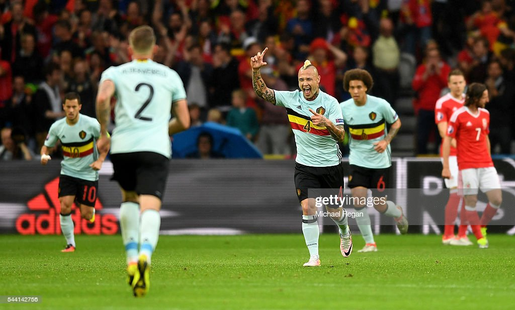 <a gi-track='captionPersonalityLinkClicked' href=/galleries/search?phrase=Radja+Nainggolan&family=editorial&specificpeople=6339191 ng-click='$event.stopPropagation()'>Radja Nainggolan</a> (C) of Belgium celebrates scoring his team's first goal during the UEFA EURO 2016 quarter final match between Wales and Belgium at Stade Pierre-Mauroy on July 1, 2016 in Lille, France.