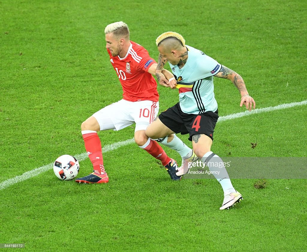 Radja Nainggolan (R) of Belgium in action against Aaron Ramsey (L) of Wales during the Euro 2016 quarter-final football match between Wales and Belgium at the Stadium Pierre Mauroy in Lille, France on July 1, 2016.