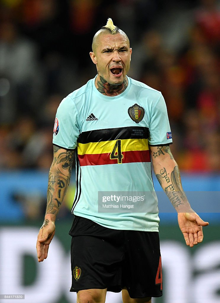 <a gi-track='captionPersonalityLinkClicked' href=/galleries/search?phrase=Radja+Nainggolan&family=editorial&specificpeople=6339191 ng-click='$event.stopPropagation()'>Radja Nainggolan</a> of Belgium reacts during the UEFA EURO 2016 quarter final match between Wales and Belgium at Stade Pierre-Mauroy on July 1, 2016 in Lille, France.