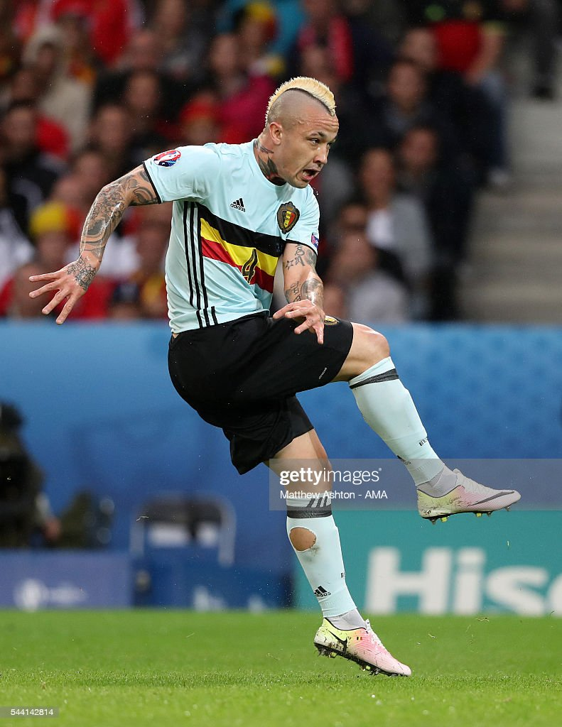 <a gi-track='captionPersonalityLinkClicked' href=/galleries/search?phrase=Radja+Nainggolan&family=editorial&specificpeople=6339191 ng-click='$event.stopPropagation()'>Radja Nainggolan</a> of Belgium scores a goal to make it 0-1 during the UEFA Euro 2016 quarter final match between Wales and Belgium at Stade Pierre-Mauroy on July 1, 2016 in Lille, France.