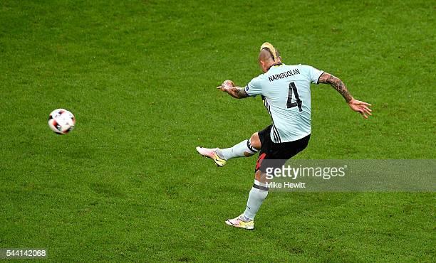 Radja Nainggolan of Belgium scores the opening goal during the UEFA EURO 2016 quarter final match between Wales and Belgium at Stade PierreMauroy on...
