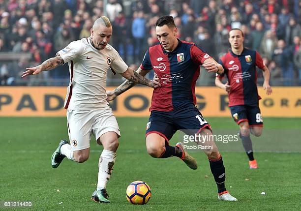 Radja Nainggolan of Roma and Lucas Ocampos of Genoa during the Serie A match between Genoa CFC and AS Roma at Stadio Luigi Ferraris on January 8 2017...