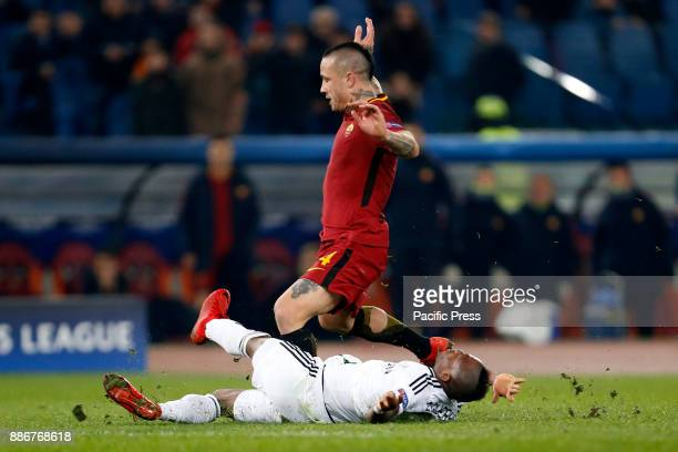 Radja Nainggolan of Roma is tackled by Donald Guerrier of Qarabag during their UEFA Champions League Group C soccer match in Rome Roma won the match...