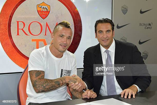Radja Nainggolan with AS Roma CEO Italo Zanzi as he renews his contract with AS Roma on July 13 2015 in Rome Italy