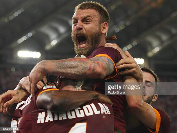 Radja Nainggolan with his teammate Daniele De Rossi of AS Roma celebrates after scoring the opening goal during the Serie A match between AS Roma and...