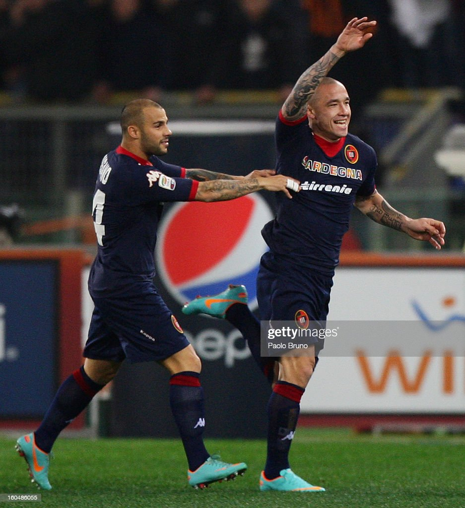 Radja Nainggolan (R) with his teammate of Cagliari Calcio celebrates after scoring the opening goal during the Serie A match between AS Roma and Cagliari Calcio at Stadio Olimpico on February 1, 2013 in Rome, Italy.