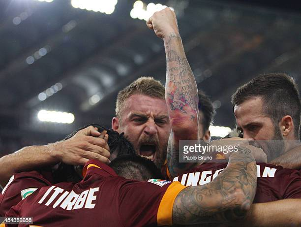 Radja Nainggolan with his teammates Daniele De Rossi and Miralem Pjanic of AS Roma celebrates after scoring the opening goal during the Serie A match...