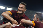 Radja Nainggolan with his teammates Francesco Totti and Miralem Pjanic of AS Roma celebrates after scoring the opening goal during the Serie A match...