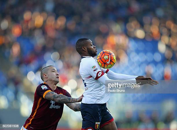 Radja Nainngolan of AS Roma competes for the ball with Olivier Ntcham of Genoa CFC during the Serie A match between AS Roma and Genoa CFC at Stadio...