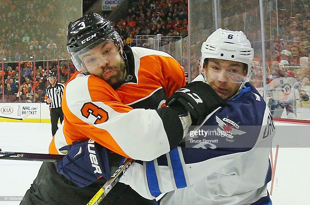 <a gi-track='captionPersonalityLinkClicked' href=/galleries/search?phrase=Radko+Gudas&family=editorial&specificpeople=5648763 ng-click='$event.stopPropagation()'>Radko Gudas</a> #3 of the Philadelphia Flyers hits <a gi-track='captionPersonalityLinkClicked' href=/galleries/search?phrase=Alexander+Burmistrov&family=editorial&specificpeople=4782297 ng-click='$event.stopPropagation()'>Alexander Burmistrov</a> #6 of the Winnipeg Jets during the first period at the Wells Fargo Center on March 28, 2016 in Philadelphia, Pennsylvania.