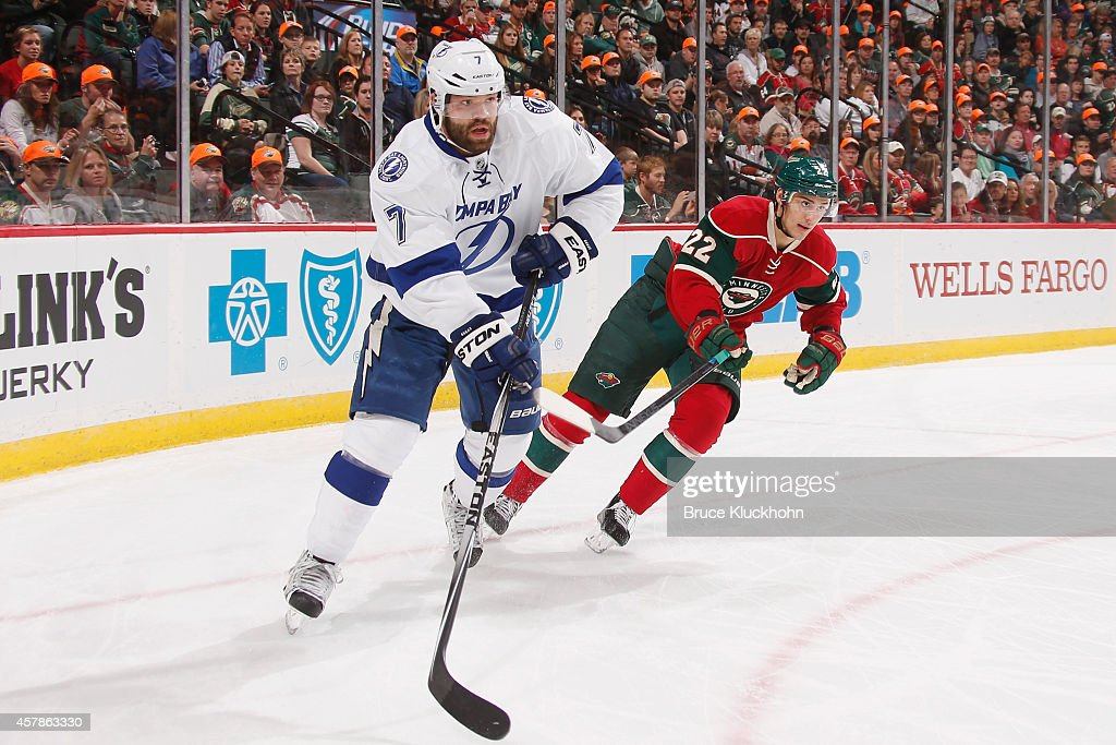 <a gi-track='captionPersonalityLinkClicked' href=/galleries/search?phrase=Radko+Gudas&family=editorial&specificpeople=5648763 ng-click='$event.stopPropagation()'>Radko Gudas</a> #7 of the Tampa Bay Lightning and <a gi-track='captionPersonalityLinkClicked' href=/galleries/search?phrase=Nino+Niederreiter&family=editorial&specificpeople=6667732 ng-click='$event.stopPropagation()'>Nino Niederreiter</a> #22 of the Minnesota Wild skate to the puck during the game on October 25, 2014 at the Xcel Energy Center in St. Paul, Minnesota.
