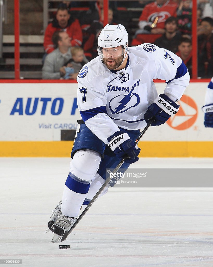 <a gi-track='captionPersonalityLinkClicked' href=/galleries/search?phrase=Radko+Gudas&family=editorial&specificpeople=5648763 ng-click='$event.stopPropagation()'>Radko Gudas</a> #7 of the Tampa Bay Lightning carries the puck during their NHL game against the Carolina Hurrianes at PNC Arena on January 19, 2014 in Raleigh, North Carolina.